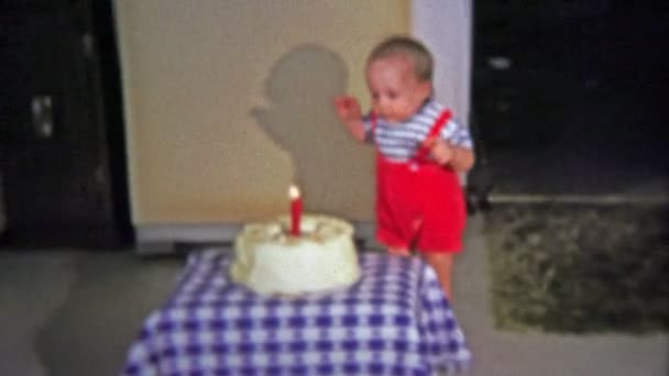 One Year Old Awkwardly Walks To Birthday Party Cake And Burns Himself On Candle Stock Filmmaterial