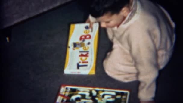 Boy plays Tickle Bee board game