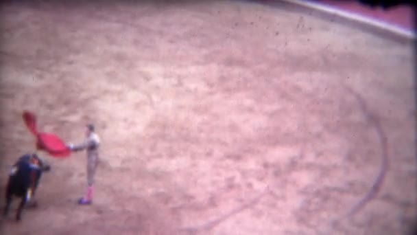 matador fights charging bull in center of rink