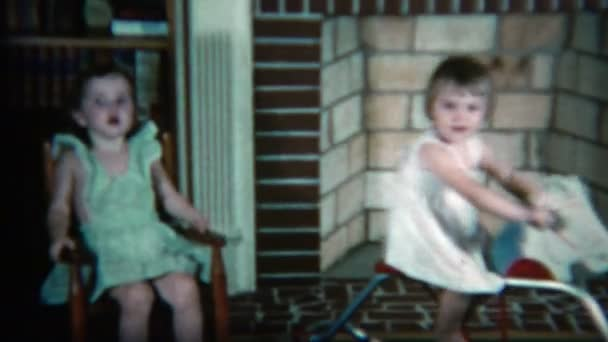 sisters playing with rocking chairs and toy horses