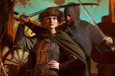 man and woman in medieval armor