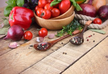 tomatoes, peppers, fresh vegetables and spices in the spoons