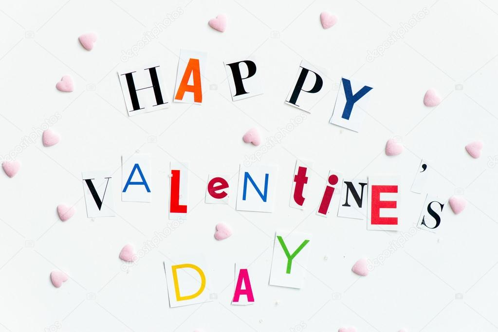 Happy valentines day letters cut out from the magazines stock colourful happy valentines day letters cut out from the magazines with little heart shaped candies nearby on white wooden backgroun photo by manuta spiritdancerdesigns Images
