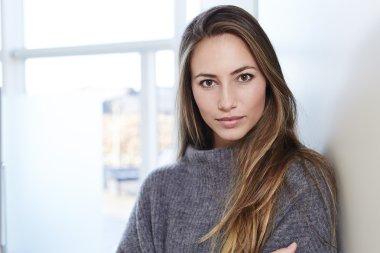 beautiful young woman in grey