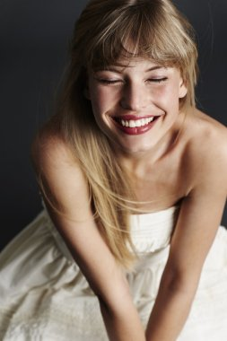 Smiling bride with eyes closed