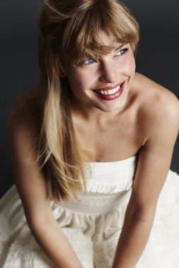 Blue eyed blond in wedding dress