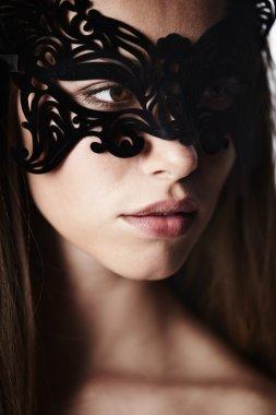 Beautiful woman in ornate mask
