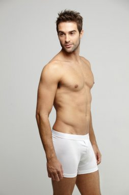 Man in underpants looking away
