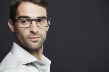 Man wearing glasses looking away