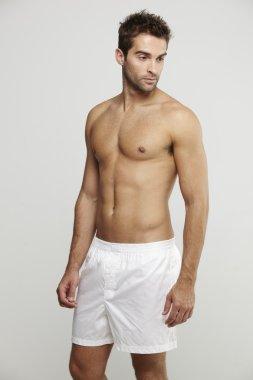 Man in boxer shorts posing