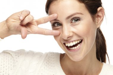 Woman making the peace sign