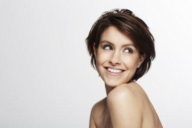 Portrait of beautiful woman smiling  in studio stock vector