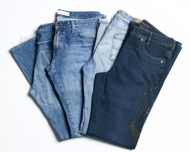 Four pairs of blue jeans