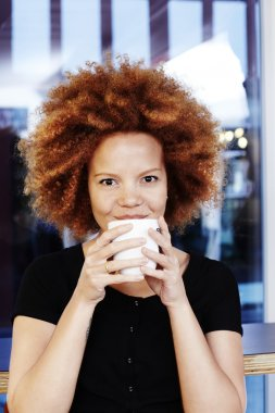 woman smiling over coffee