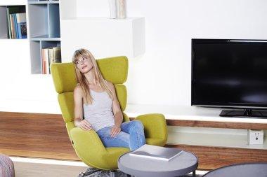 Woman sit in designer chair