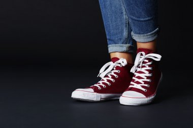 Young woman in jeans and sneakers