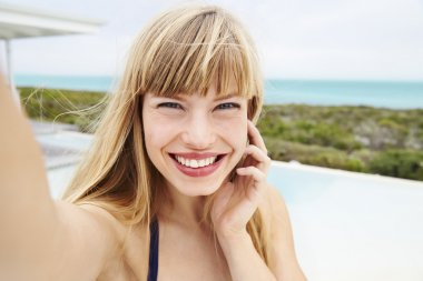 Smiling young woman looking at camera stock vector