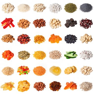 Large collection of different spices, herbs, nuts, dried fruits, beans, berries isolated on white background.