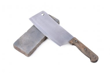 Sharpening or honing a knife on a waterstone, grindstone on the