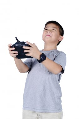 Little boy holding a radio remote control for helicopter, drone