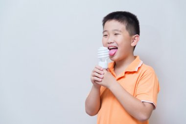 Asian boy joking gesture licking fake ice cream made with energy