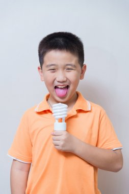 Asian boy joking gesture licking fake ice cream made with energy