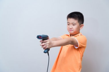 Asian boy aim a fake gun made with barcode scanner