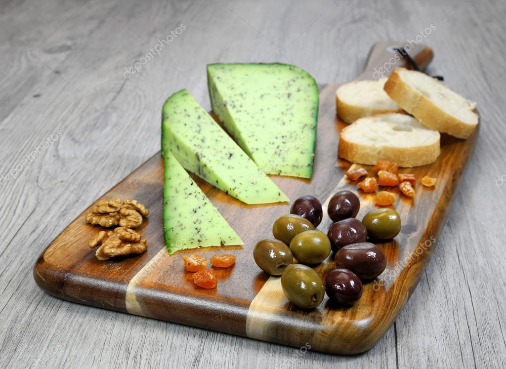 Cheese Plate French solid cheese and olives provencal \u2014 Stock Photo & Cheese Plate: French solid cheese and olives provencal \u2014 Stock Photo ...