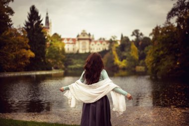 Girl in the forest with castle