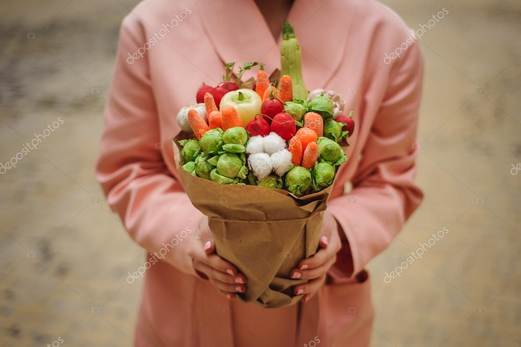 The original unusual edible vegetable and fruit bouquet in woman ...