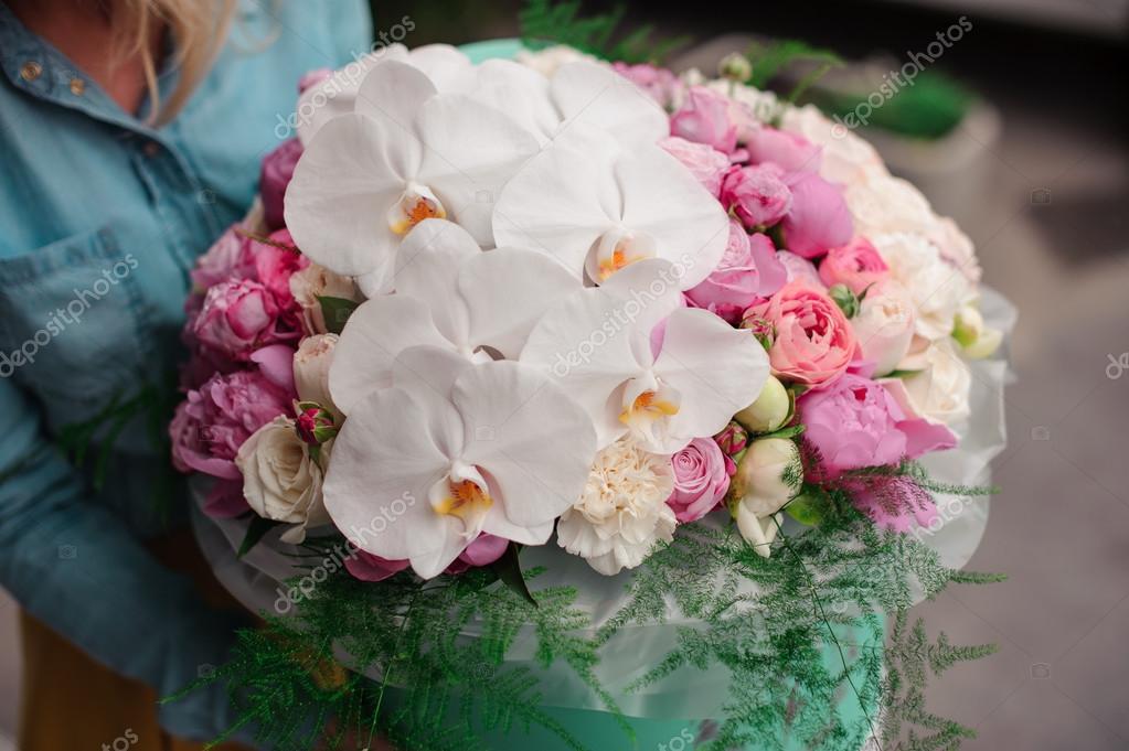 Girl holding beautiful mix white and pink flower bouquet in round girl holding beautiful mix white and pink flower bouquet in round box with lid stock mightylinksfo