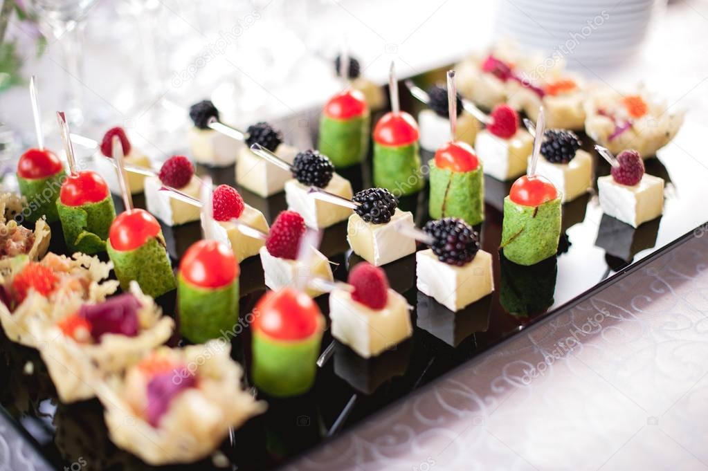 mixed fingerfood canapes on appetizer table stock photo fesenko 84597348