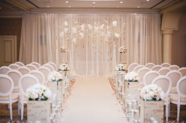 Beautiful wedding ceremony design decoration elements with arch, floral design, flowers, chairs