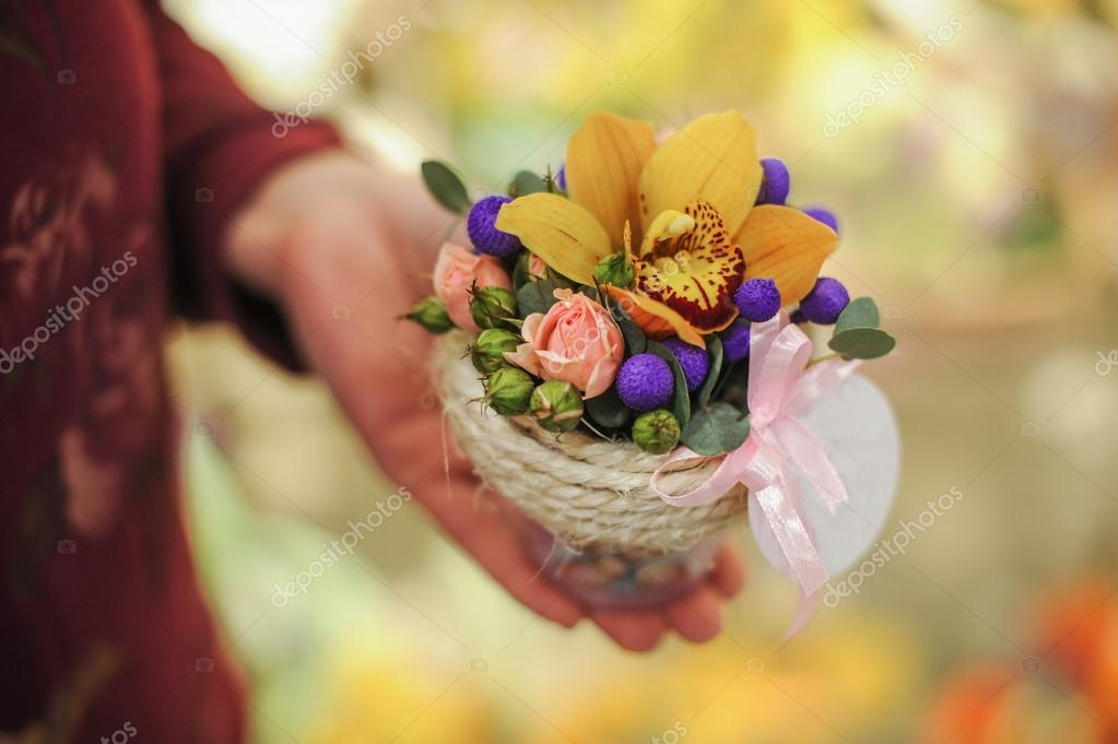 Basket with yellow orchid flowers.