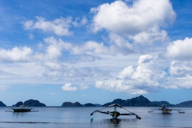 Fishing boats is in the sea near the beach Corong-Corong on the island of Palawan in the El Nido (Philippines)