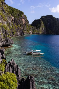 Fishing and excursion boat is in the sea near the island of Palawan in the El Nido (Philippines)