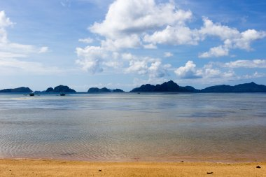 A Fishing and excursion boat is on the beach near the island of Palawan in the El Nido (Philippines)