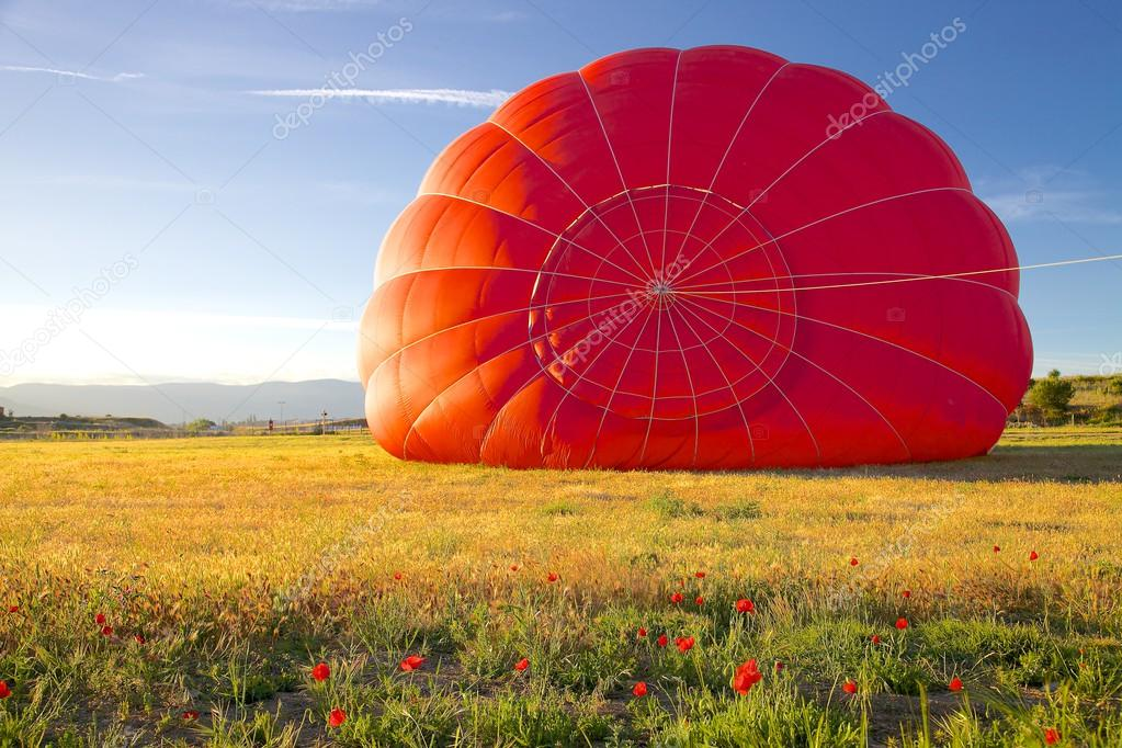 Red Hot Air Balloon Being Inflated