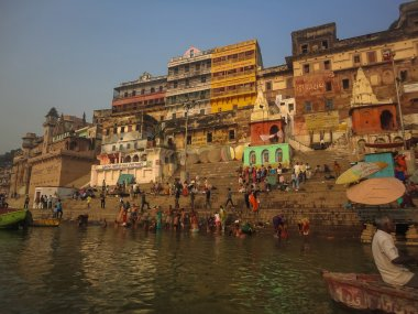 Unidentified Hindu pilgrims take a holy bath in the river Ganges in Varanasi, India. Ganges is the most sacred river to Hindus and ranked as the fifth most polluted river of the world in 2007. stock vector