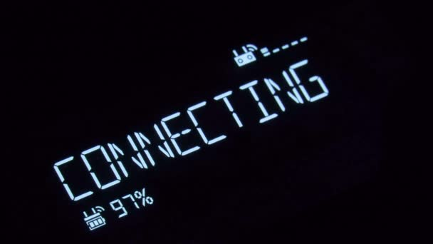 A text message appearing with a decoding fx and a deep glow: connecting,