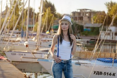 Nikopol, Ukraine, 08.09.2015. The beautiful girl on walk on the yacht club mooring