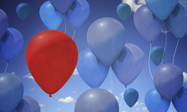 Colorful balloons against a summmer sky.