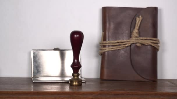 antique vintage retro stamp in a notary and lawyer office - sign a contract and stamp the agreement with sealing wax