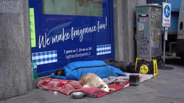 Europe, Italy , Milan April 2021 - lifestyle in downtown of the city empty of people during Covid-19 Coronavirus lockdown quarantine home - poor homeless and dog sleeping