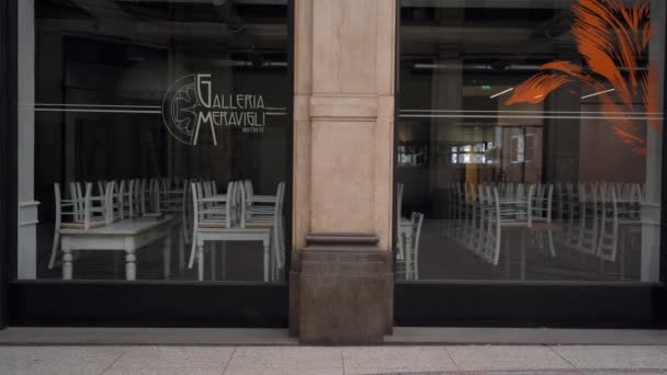 Europe, Italy , Milan April 2021 - lifestyle in downtown of the city empty of people during Covid-19 Coronavirus lockdown quarantine home - closed shop, restaurant and pub in Galleria Meravigli