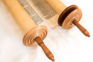 The Hebrew handwritten Torah scroll, on a synagogue alter, illustrating Jewish holidays, during fests. Closed version
