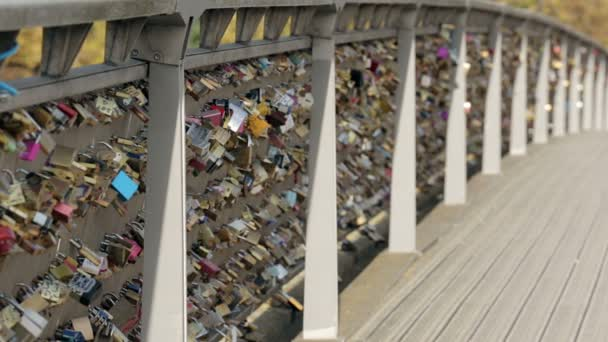 Padlocks of love on a bridge in Paris. Establishing shot