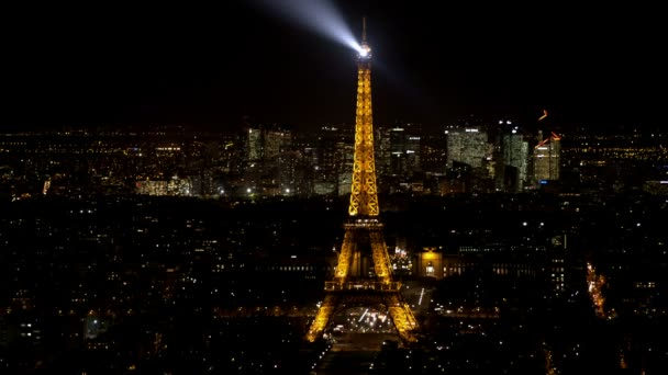 Aerial view of the eiffel tower and la defense at night