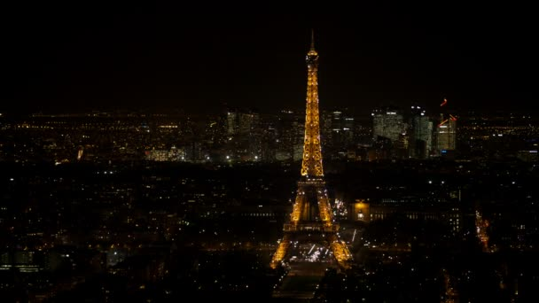 Sparkling Eiffel tower in Paris seen at night from an aerial view
