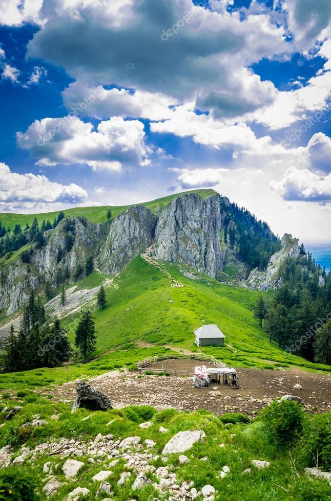 Mountain landscape with sheepfold in Carpathian Mountains, Roman